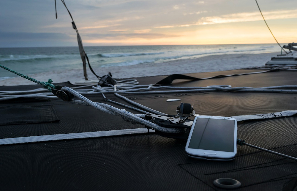 a smartphone lying on the deck of a ship